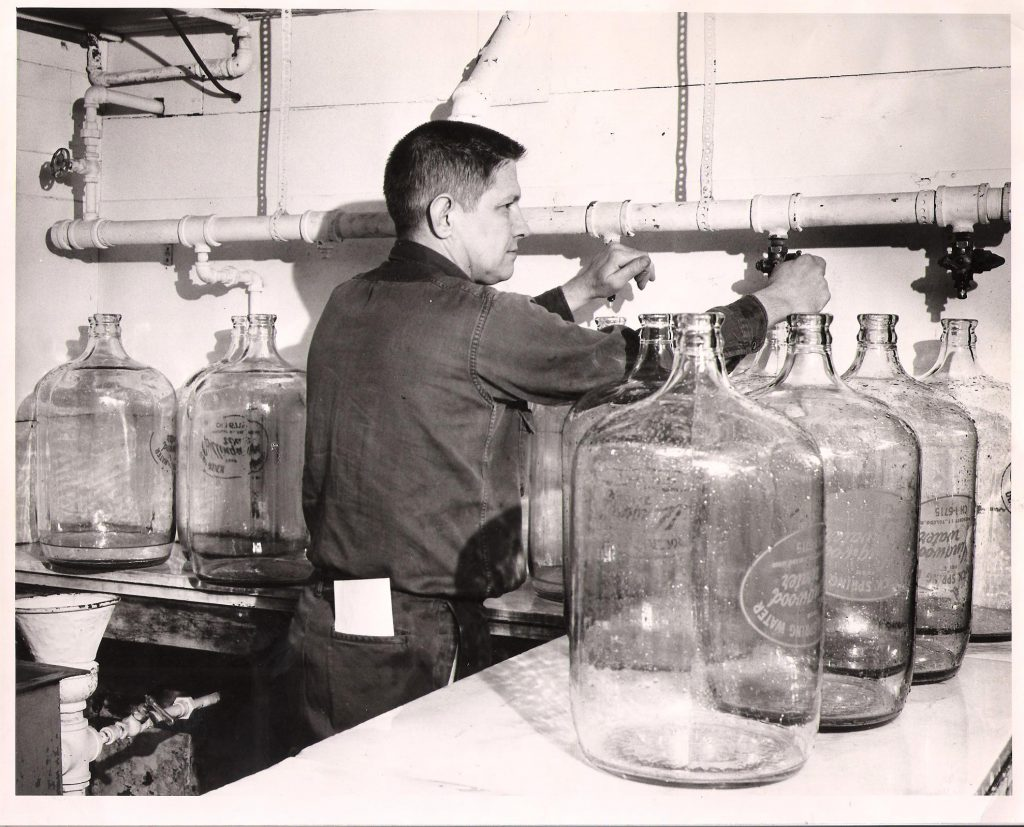 Don Ormsby bottling water in old building 1959 Collingwood Water Toledo Ohio